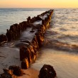 Old breakwater in North sea at sunset — Stock Photo #27889239