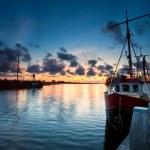 Fishing ships at sunset in Zoutkamp — Stock Photo
