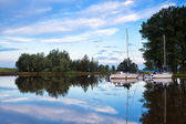 Yachts on river in early morning — Stock Photo