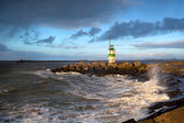 North sea waves and lighthouse in Ijmuiden, Holland — Stock Photo