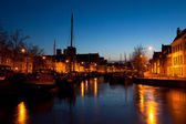 Ship on canal in Dutch city at night — Stock Photo
