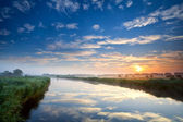 Orange sunrise over wide river — Stock Photo