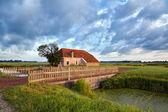 Charming farmhouse and blue sky — Stock Photo