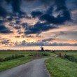 Bike path to windmill at sunrise, Holland — Stock Photo