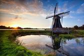 Charming Dutch windmill at sunset — Stock Photo
