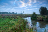 Dutch windmill and blue morning sky — Stock Photo