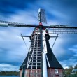 Stock Photo: Dutch windmill and clouded sky