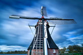 Dutch windmill and clouded sky — Stock Photo