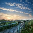 Wooden bridge for bikes at sunrise — Foto Stock