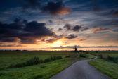 Bike road to windmill at sunrise — Foto de Stock