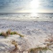 Stock Photo: Sunshine over sand beach and North sea