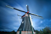 Dutch windmill over sky — Stockfoto