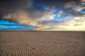 Sunset sky over sand beach — Stock Photo
