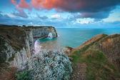 Sunrise over cliffs in Atlantic ocean — Stock Photo