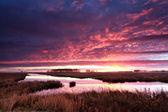 Fire dramatic sunrise over river — Stock Photo