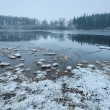 Stock Photo: Misty clouded winter morning on lake