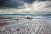 Stormy dark sky over Atlantic ocean beach — Stock Photo