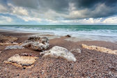 Stormy clouded sky over beach in ocean — Stock Photo