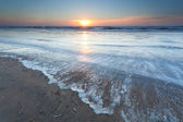 Gold sunset over North sea beach — Stock Photo