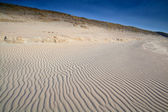Wave sand texture on beach dunes — Stock Photo