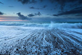 Ocean waves in dusk with long exposure — Stock Photo