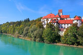 Old palace by river in Fussen — Stock Photo