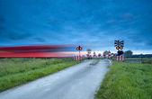 Train on railway with long exposure — Stock Photo