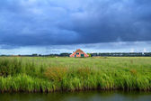 Clouded sky over Dutch farmland — Stock Photo
