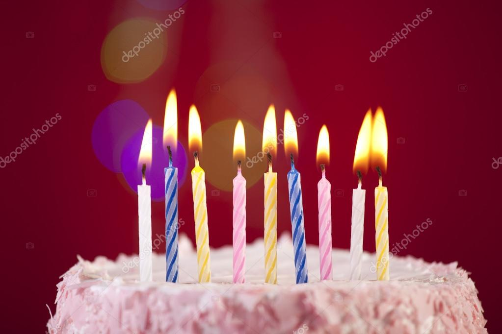 Happy birthday cake shot on a red background with candles — Stock Photo #18360769