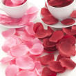 Coffee cup and rose petals — Stock Photo