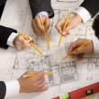 Meeting team of engineers working on construction project at — Stock Photo #24853401