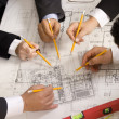 Stock Photo: Meeting the team of engineers working on construction project at