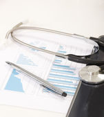 Digital tablet with stethoscope and paperwork — Stock Photo