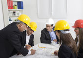 Architects working in office on construction project — Stock Photo