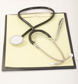 Medical Stethoscope with Pen on Medical File Folders — Stock Photo