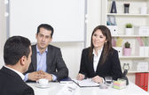 Man explaining about her profile to business managers at a job i — Stock Photo