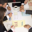 Businesspeople working together at meeting, discussing document — Stock Photo
