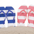 Flip-flops in sand isolated over white background. — Stock Photo