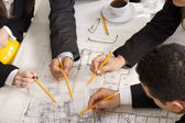 Meeting the team of engineers working on construction project at — Stock Photo