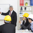 Architect giving presentation to a small business group. — Stock Photo