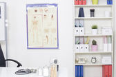 Doctor's office desk with medical supplies documents stethoscope — Foto Stock