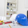 Stock Photo: Hardhat and measuring instruments on blueprint