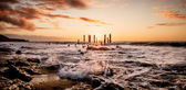 Sunset over jetty remains — Stock Photo