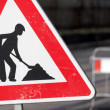 Road sign in a street under reconstruction — Stock Photo #32474651