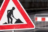 Road sign in a street under reconstruction — Stock Photo