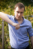 Handsome man in blue shirt — Stock Photo