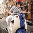 Man in helmet riding scooter — Stock Photo
