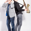 DJ and saxophonist posing in studio — Stock Photo