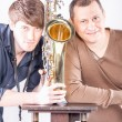 Two men posing with saxophone — Stock Photo
