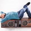 Dj lying on vintage loudspeaker — Stock Photo